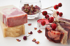 Handmade Organic Soap. Spa set - handmade rose organic soap, dried rose flowers, and rosehips. Best suited for relaxing and health commercials Royalty Free Stock Image