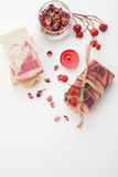 Handmade Organic Soap. Spa set - handmade rose organic soap, dried rose flowers, and rosehips. Best suited for relaxing and health commercials Royalty Free Stock Photo