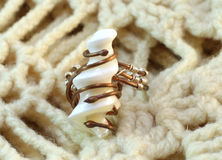Handmade original ring of mother-of-pearl and wire. On the knitted background Royalty Free Stock Images