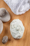 Handmade ornamental soaps with lavender bunch and stones on wooden board, product of cosmetics or body care Stock Image
