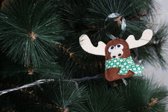 Handmade owl from felt on Christmas tree with cones Stock Images
