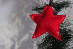 Handmade owl from felt on Christmas tree with cones Stock Photos