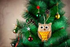 Handmade owl on the tree Stock Image