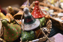 Handmade painted bells, christmas decoration. Handmade painted bells  for sale in a Christmas fair.This bells are made from clay by potters and then hand Stock Image