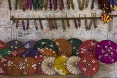 Handmade painted paper umbrellas in small Burmese shop. Horizontal photo of colorful handmade open and closed painted paper umbrellas in small Burmese shop royalty free stock photos