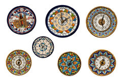 Handmade  painted wall-plates clocks Stock Photos