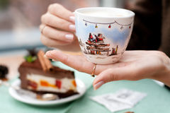 A handmade painting white cup of Christmas mood Royalty Free Stock Image