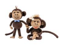 Handmade pair of monkeys on white background. Isolated Stock Photos