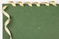 Handmade paper. Handmade green paper with ribbon Royalty Free Stock Photos