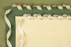 Handmade paper. Handmade green paper with ribbons Royalty Free Stock Images