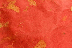 Handmade paper. Handmade red paper with leaves for background texture Stock Photo