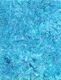 Handmade Paper Teal. Teal blue handmade paper with strands of multi-colored thread; could be used for background royalty free illustration