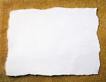 Handmade paper background. Torn white paper lying over a textured handmade paper stock images