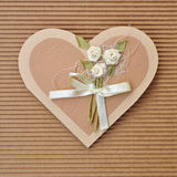 Handmade paper card love heart shape. Decorated with flowers and a bow brown colors Stock Images