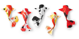 Handmade paper craft origami koi carp fish on white background. Stock Photo
