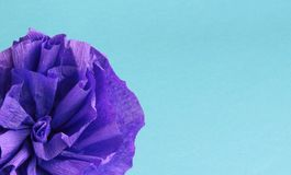 Handmade paper flower. Blue paper flower on blue background. Handmade decoration Stock Photo