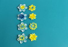 Handmade paper flowers on blue background. Favorite hobby. Floral pattern. Advertising. Blue, blue and yellow flowers Royalty Free Stock Photos