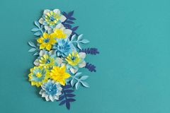 Handmade paper flowers on blue background. Favorite hobby. stock photography