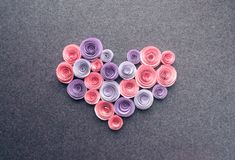 Handmade paper flowers heart on dark felt background. Beautiful royalty free stock photos