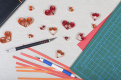 Handmade paper hearts with tools for quilling Royalty Free Stock Photography