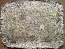 Handmade paper with natural flowers Stock Image