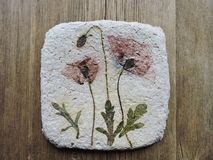 Handmade paper with natural poppy flowers stock photos