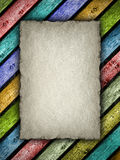 Handmade paper sheet on colorful planks Stock Image