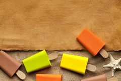 Handmade paper sheet and ice lollies Stock Image