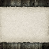 Handmade paper sheet on planks background Stock Photography