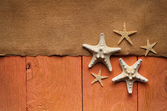 Handmade paper sheet and starfish on wooden planks Royalty Free Stock Image