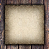 Handmade paper sheet on wooden planks Royalty Free Stock Photography