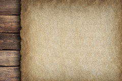 Handmade paper sheet on wooden planks Royalty Free Stock Image