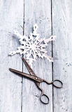 Handmade paper snowflake and vintage scissors Royalty Free Stock Images