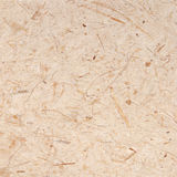Handmade paper with straw texture background Royalty Free Stock Photos