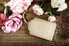 Handmade paper tag with string and roses Stock Image
