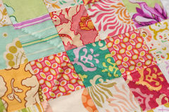 Handmade Patchwork Quilt. Detail from a handmade patchwork quilt made with squares Stock Photography