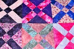 Handmade patchwork quilt texture backround. English handmade patchwork quilt texture background royalty free stock photos