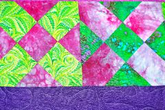 Handmade patchwork quilt texture backround. English handmade patchwork quilt texture background royalty free stock photo
