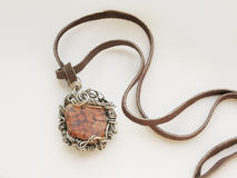 Handmade pendant. A beautiful handmade wire wrapped pendant Stock Photo