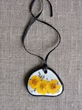 Handmade pendant from dried pressed yellow   flower Royalty Free Stock Photography