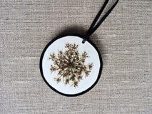Handmade pendant from flower Stock Photo