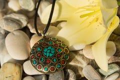 Handmade pendant  from Nepal Royalty Free Stock Photo