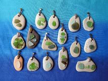 Handmade pendant using sea glass and sea stone, Lithuania stock image