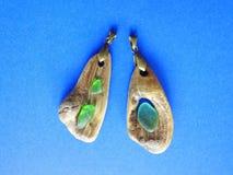 Handmade pendant using sea wood and glass, Lithuania royalty free stock photos