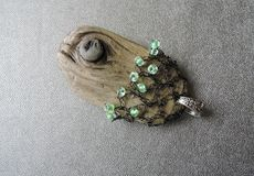Sea wood pendant with beads Stock Photography