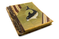 Handmade photo album with dolphin on the cover. stock photos