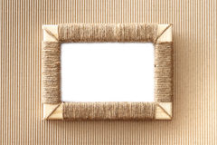 Handmade photo frame braided jute against corrugated fibreboard background Stock Image