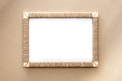 Handmade photo frame braided jute against corrugated fibreboard background Stock Photo