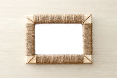 Handmade photo frame braided jute against wooden background Royalty Free Stock Photos