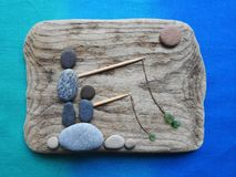 fisher mans picture using sea wood, stones and glass, Lithuania royalty free stock photography